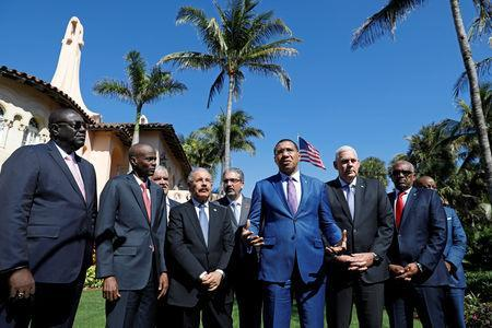 Standing with other Caribbean leaders, Jamaica Prime Minister Andrew Holness speaks after a meeting with U.S. President Donald Trump at Mar-a-Lago in Palm Beach, Florida, U.S., March 22, 2019. REUTERS/Kevin Lamarque