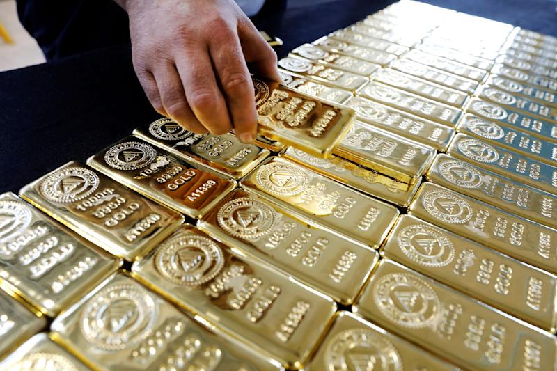 Gold at three-week low on firmer dollar, US jobs data
