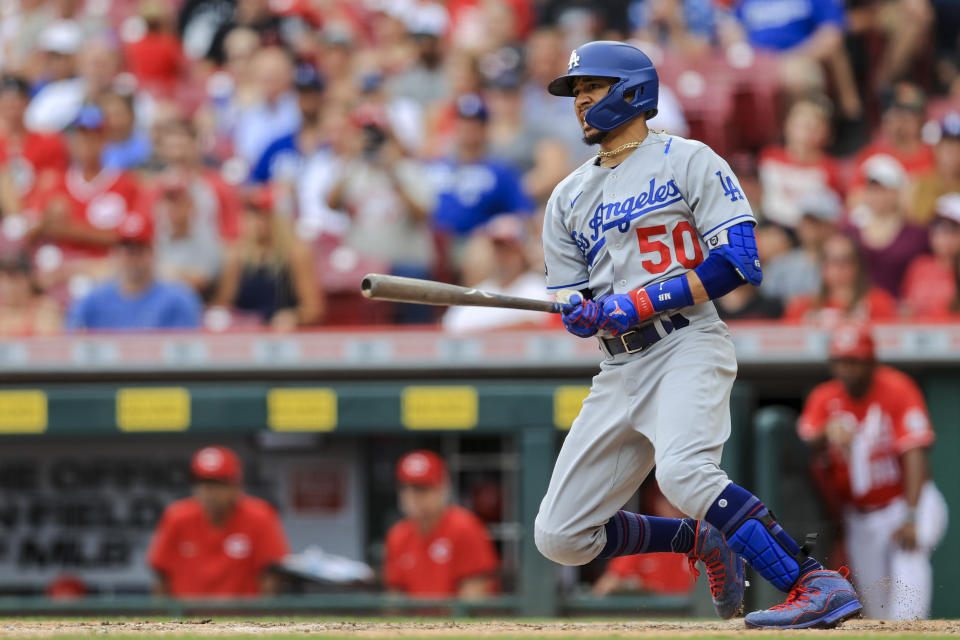 Los Angeles Dodgers' Mookie Betts hits an RBI-single during the ninth inning of a baseball game against the Cincinnati Reds in Cincinnati, Saturday, Sept. 18, 2021. (AP Photo/Aaron Doster)