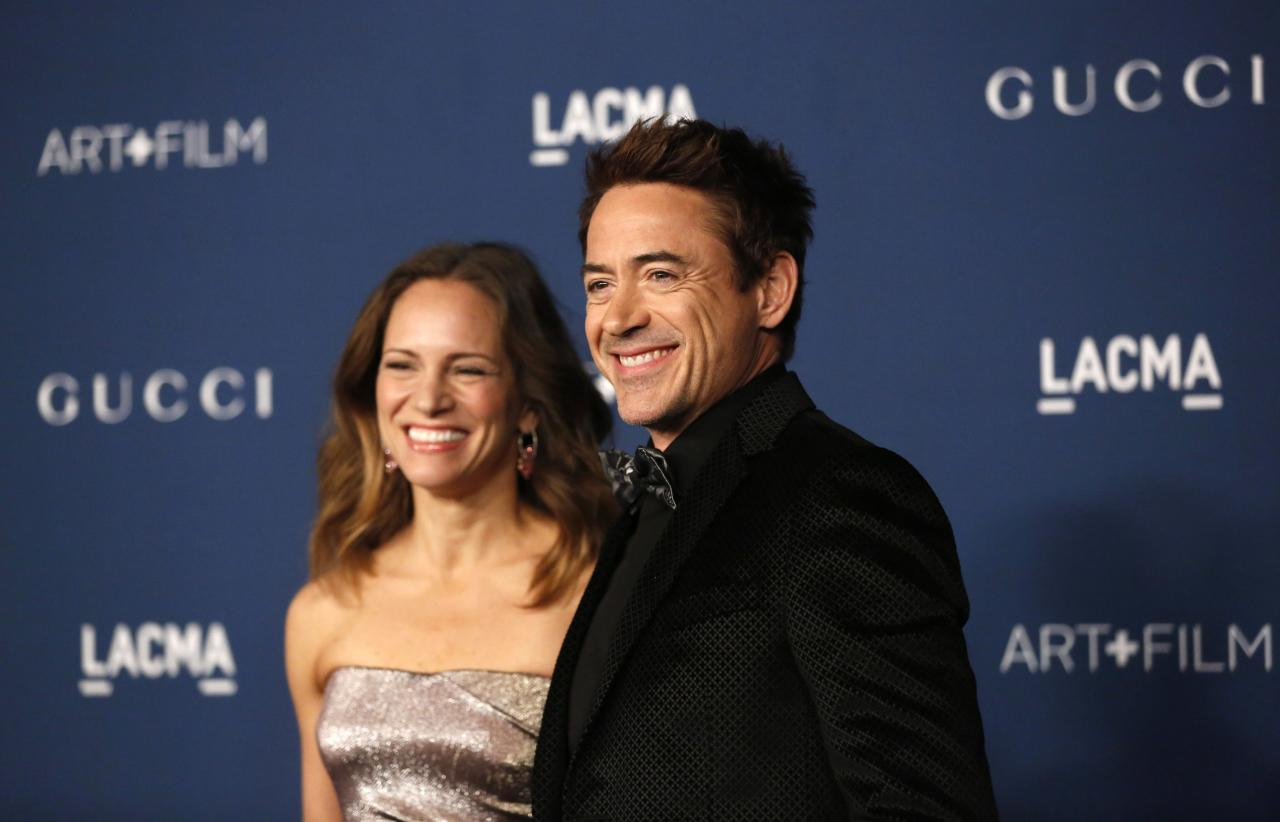 Actor Robert Downey Jr. and his wife Susan pose at the Los Angeles County Museum of Art (LACMA) 2013 Art+Film Gala in Los Angeles, California November 2, 2013. REUTERS/Mario Anzuoni (UNITED STATES - Tags: ENTERTAINMENT)