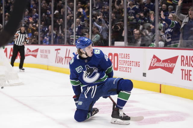 Vancouver Canucks' Adam Gaudette celebrates his goal against the Chicago Blackhawks during the second period of an NHL hockey game Wednesday, Feb. 12, 2020, in Vancouver, British Columbia. (Darryl Dyck/The Canadian Press via AP)