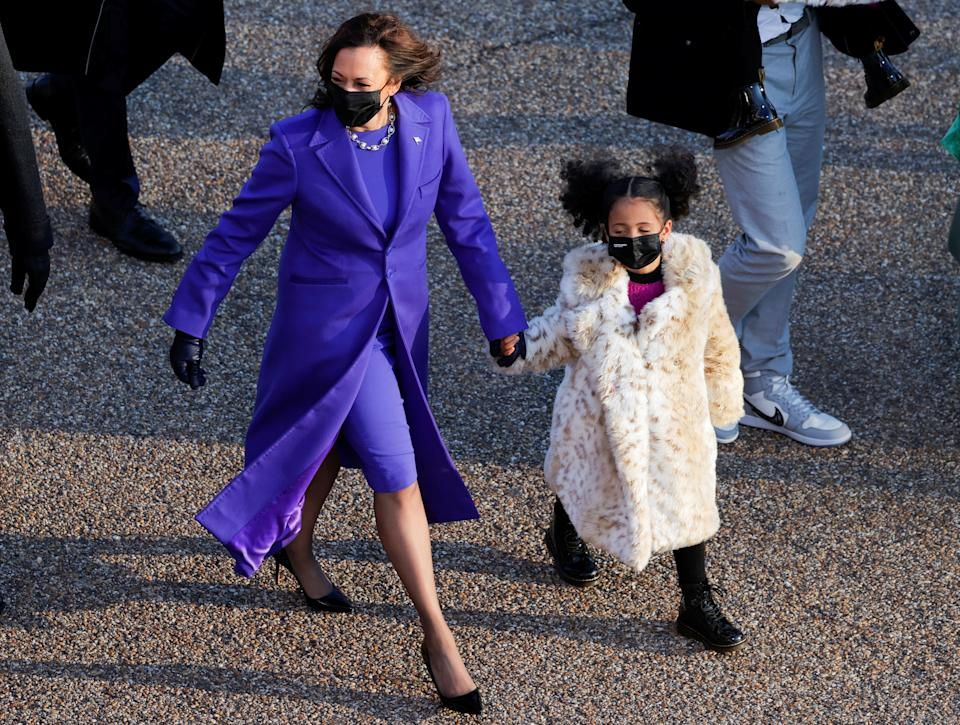 Vice President Kamala Harris walks with her great-niece Amara Ajagu to the White House during the Inauguration Day parade, in Washington, U.S., January 20, 2021. (Andrew Kelly/Reuters)