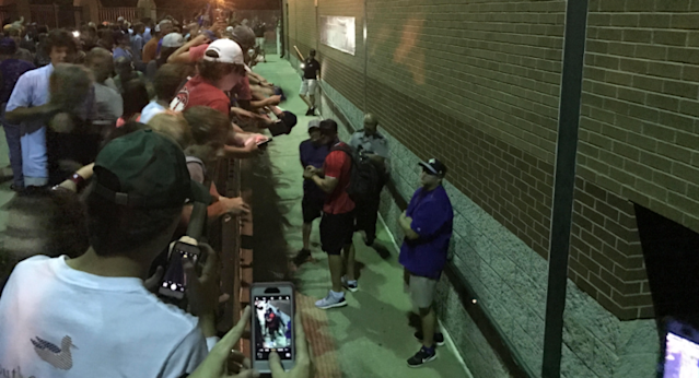 Tim Tebow signs for the crowds in Augusta. (Yahoo Sports)
