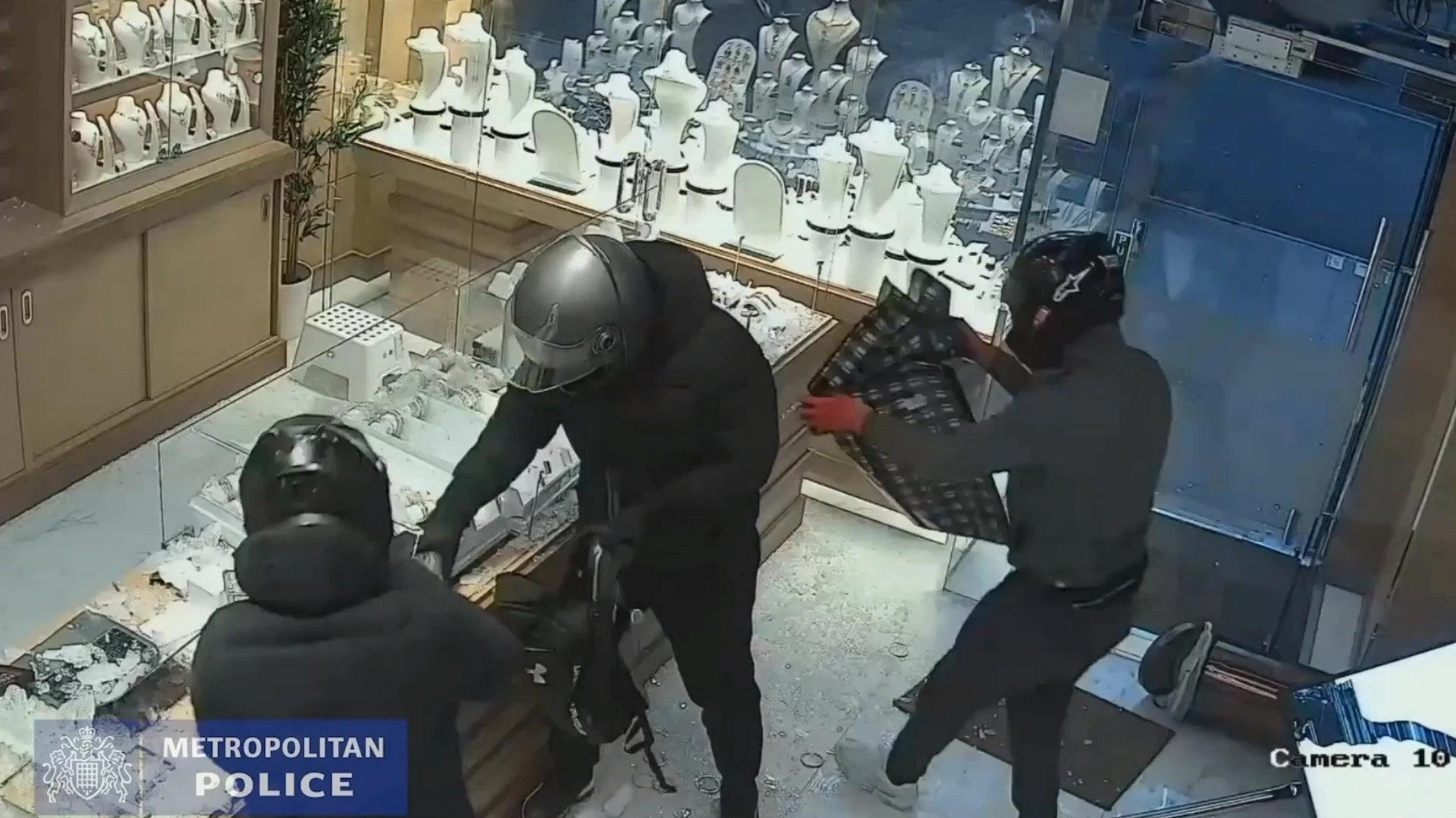 Video grab of members of the gang taking jewellery from the jewellery cases. Video shows the dramatic moment a gang of armed robbers smashed their way into a jewellery shop using a luxury Range Rover, before one the members of the gang was detained by a member of public attempting to get away. See National News story NNraid. A gang of armed robbers smashed their way into a jewellery shop using a luxury Range Rover, before members of the public stopped one of them from running away. Ben Wegener, 34, pleaded guilty to robbery, dangerous driving, and possession of offensive weapon, criminal damage and receiving stolen goods. He and two accomplices drove a black Range Rover through the front of a jewellery shop in Shepherds Bush, west London. When the vehicle narrowly missed the people inside, the robbers got out and then smashed the glass display cases using a sledgehammer and a hammer, and put items of jewellery into bags.