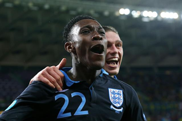 KIEV, UKRAINE - JUNE 15: Danny Welbeck of England celebrates scoring their third goal with Andy Carroll of England during the UEFA EURO 2012 group D match between Sweden and England at The Olympic Stadium on June 15, 2012 in Kiev, Ukraine. (Photo by Alex Livesey/Getty Images)