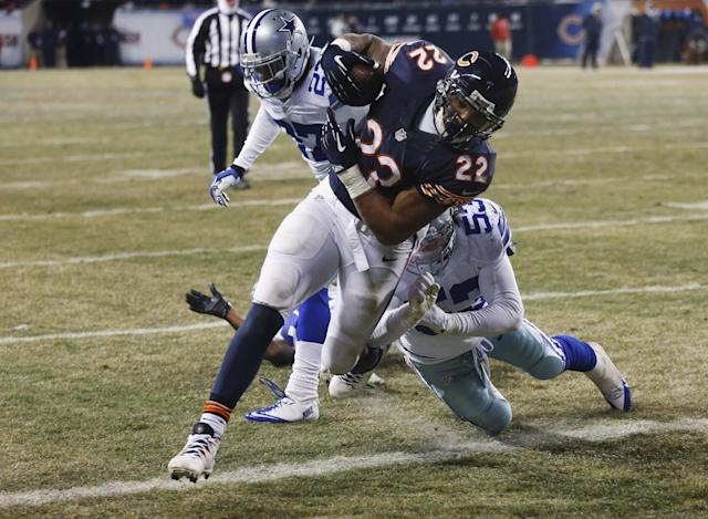 Chicago Bears running back Matt Forte (22) scores a touchdown past Dallas Cowboys linebacker Cameron Lawrence (53) and safety J.J. Wilcox (27) during the second half of an NFL football game, Monday, Dec. 9, 2013, in Chicago. (AP Photo/Charles Rex Arbogast)