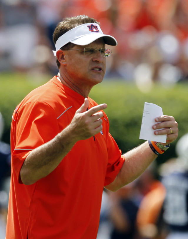 Auburn head coach Gus Malzahn signals to players during warm ups before an NCAA college football game against Arkansas on Saturday, Aug. 30, 2014, in Auburn, Ala. (AP Photo/Butch Dill)