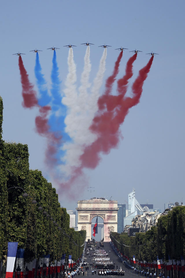 <p>French Alphajets of the Patrouille de France fly over the Champs-Élysées, with the Arc de Triomphe in background, during the Bastille Day parade in Paris, France, Saturday, July 14, 2018. (Photo: Francois Mori/AP) </p>