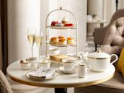 """<p>Looking for a royal-inspired hotel afternoon tea? The Crown Jewel Afternoon Tea at <a href=""""https://go.redirectingat.com?id=127X1599956&url=https%3A%2F%2Fwww.booking.com%2Fhotel%2Fgb%2Ffour-seasons-london-at-ten-trinity-square.en-gb.html%3Faid%3D2070929%26label%3Dhotel-afternoon-tea&sref=https%3A%2F%2Fwww.redonline.co.uk%2Ftravel%2Fg37102406%2Fhotel-afternoon-tea%2F"""" rel=""""nofollow noopener"""" target=""""_blank"""" data-ylk=""""slk:Four Seasons Hotel London at Ten Trinity Square"""" class=""""link rapid-noclick-resp"""">Four Seasons Hotel London at Ten Trinity Square</a> takes inspiration from the treasures stored in the nearby Tower of London. Its selection of pastries are named Ruby, Coin, Pearl and Crown, which is made with peach, verbena and yuzu, inspired by St Edward's Crown.</p><p>It's not all about the edible treats here as the setting is just as memorable. Guests take afternoon tea in an elegant space underneath a beautiful domed ceiling. As you tuck into mini savoury and sweet delights, you can sip on one ofnine different champagnes.</p><p><strong>Price: </strong>From £40 per person</p><p><a class=""""link rapid-noclick-resp"""" href=""""https://go.redirectingat.com?id=127X1599956&url=https%3A%2F%2Fwww.booking.com%2Fhotel%2Fgb%2Ffour-seasons-london-at-ten-trinity-square.en-gb.html%3Faid%3D2070929%26label%3Dhotel-afternoon-tea&sref=https%3A%2F%2Fwww.redonline.co.uk%2Ftravel%2Fg37102406%2Fhotel-afternoon-tea%2F"""" rel=""""nofollow noopener"""" target=""""_blank"""" data-ylk=""""slk:BOOK A ROOM"""">BOOK A ROOM</a></p>"""