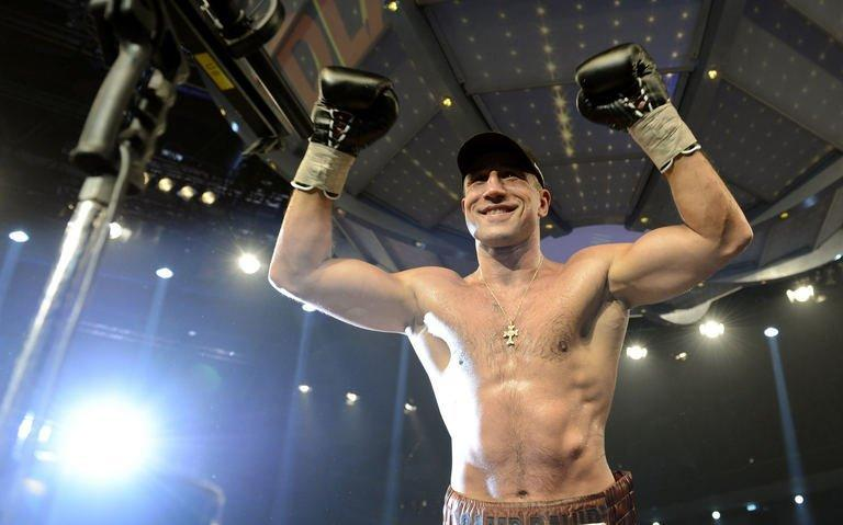 Armenian-German super middleweight boxer Arthur Abraham celebrates victiory over French challenger Mehdi Bouadla after the WBO Super-middleweight title boxing match in Nuremberg, southern Germany on December 15, 2012. Abraham won the fight in the 8th round