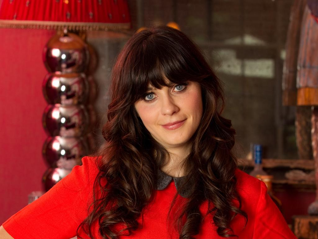 """With Zooey Deschanel's girly frocks and awkward onscreen characters, the blue-eyed beauty from """"New Girl"""" is the Queen of Adorkable. As if she already weren't adorable enough, the actress sings on the """"Winnie the Pooh"""" soundtrack!"""