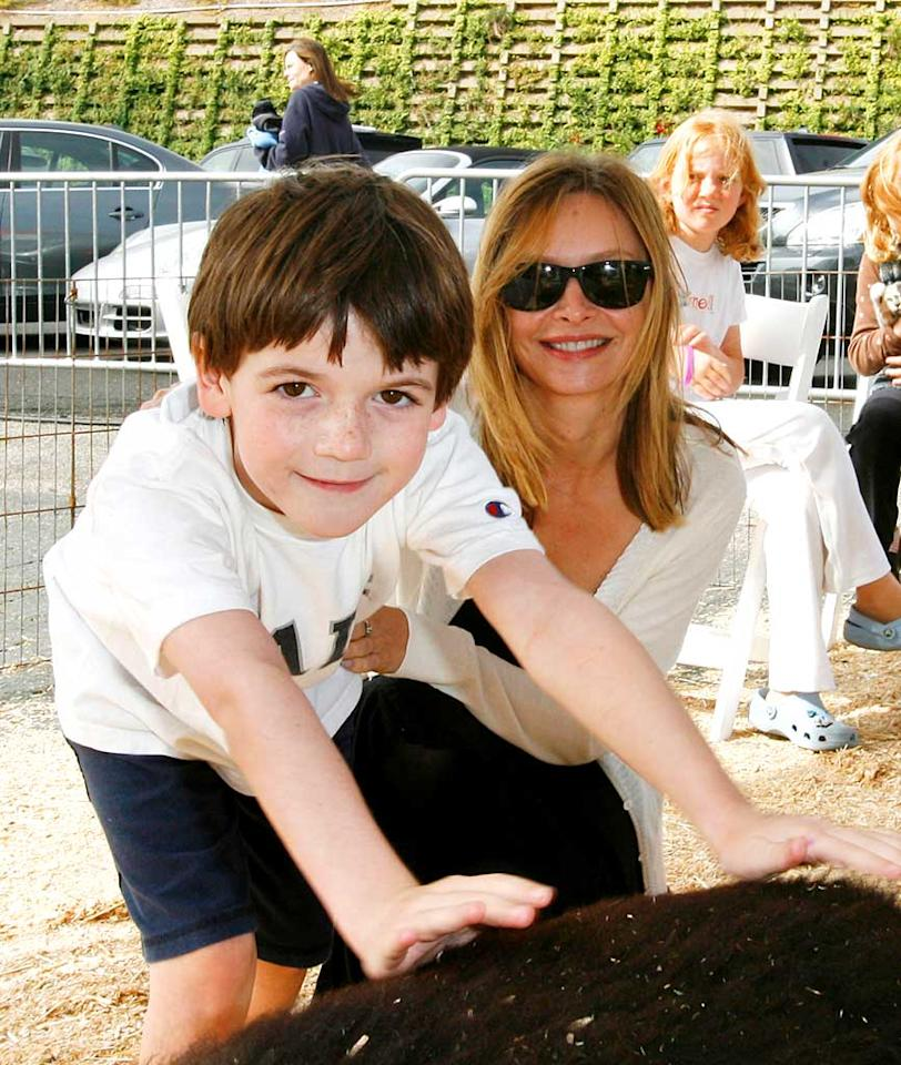 "Calista Flockhart's son Liam gets up close and personal with a furry friend. Donato Sardella/<a href=""http://www.wireimage.com"" target=""new"">WireImage.com</a> - November 4, 2007"