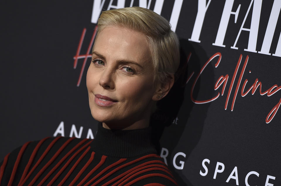 Charlize Theron arrives at the Annenberg Space for Photography's Vanity Fair: Hollywood Calling Exhibit Opening on Tuesday, Feb. 4, 2020, in Los Angeles. (Photo by Jordan Strauss/Invision/AP)