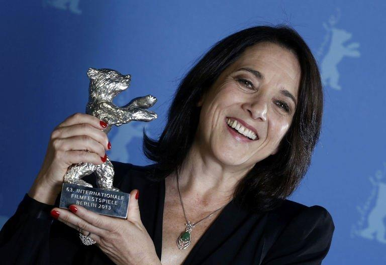 """Chilean actress Paulina Garcia poses backstage with her Silver Bear award for Best Actress for the movie """"Gloria"""" during the awards ceremony of the 63rd Berlinale Film Festival in Berlin on February 16, 2013"""