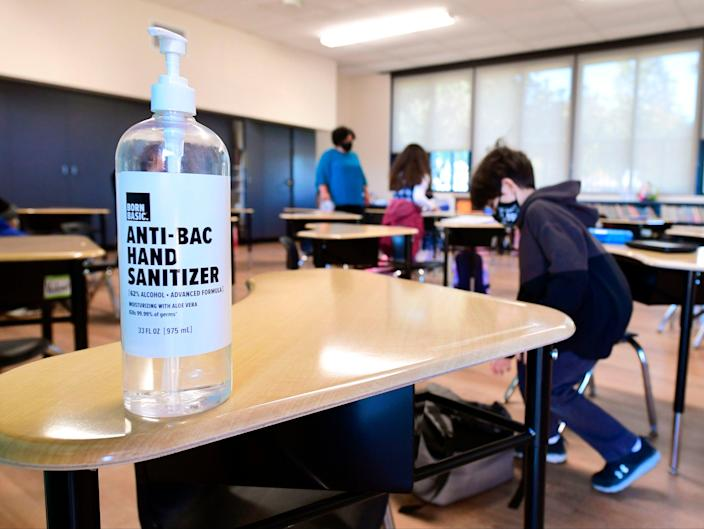 A large container of hand sanitizer sits on a desk for students to use in Second Grade instructor Marisela Sahagun's classroom at St Joseph Catholic School in La Puente, California on 16 November 2020 (AFP via Getty Images)