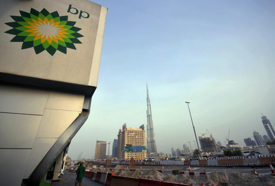 The British Petroleum logo is seen near a petrol station in Dubai with the Burj Khalifa tower in the background July 7, 2010. BP's Chief Executive Tony Hayward met officials from Abu Dhabi on Wednesday as prospects for fresh investment and progress toward closing a leaking U.S. oil well lifted the company's battered shares. REUTERS/Jumana ElHeloueh (UNITED ARAB EMIRATES - Tags: ENERGY BUSINESS POLITICS)