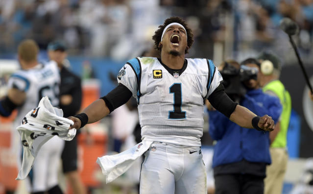 Carolina Panthers' Cam Newton (1) celebrates during the second half of an NFL football game against the Dallas Cowboys in Charlotte, N.C., Sunday, Sept. 9, 2018. (AP Photo/Mike McCarn)