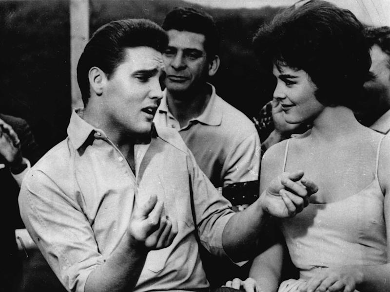 "FILE -   Elvis Presley, left, appears in a scene from the movie, ""Kid Galahad,"" in this undated file photo. A parent in a Salt Lake City suburb, who was upset about Elvis Presley songs in a high-school drama, prompted educators to cancel the production, deeming it too sexually suggestive. Presley's song lyrics and a scene suggesting cross-dressing were deemed offensive by West Jordan, Utah, school administrators. (AP Photo, file)"