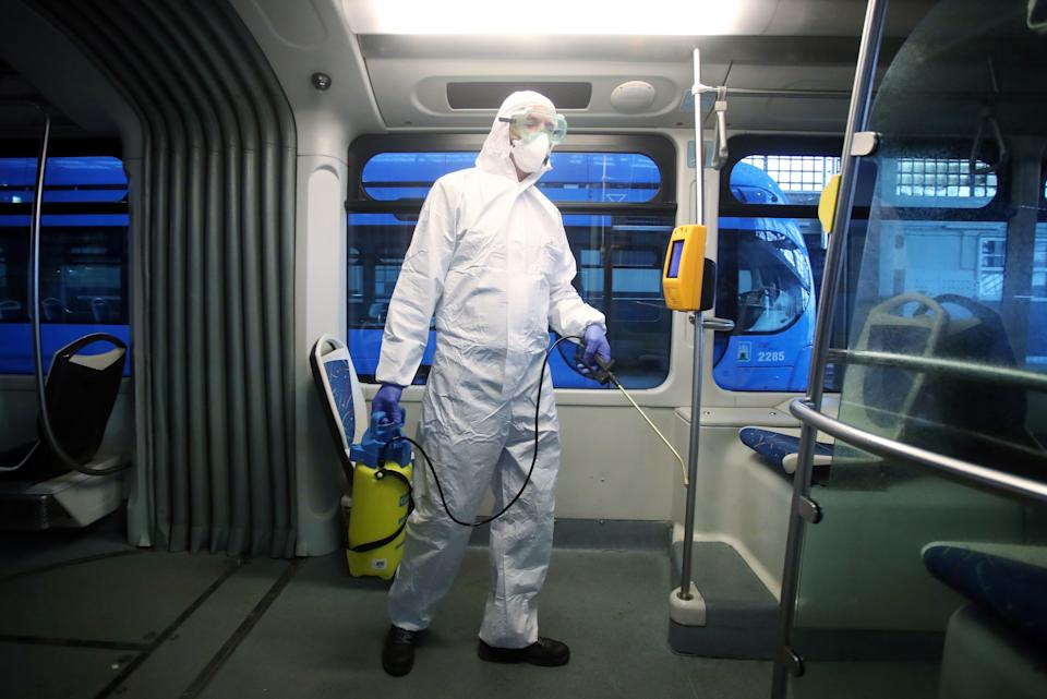 A employee wearing a protective jumpsuit disinfects a local tram in Zagreb as a precaution against the spread of COVID-19 caused by novel coronavirus on March 13, 2020. - Since the novel coronavirus first emerged in late December 2019, more than 135,640 cases have been recorded in 122 countries and territories, killing 5,043 people, according to an AFP tally compiled on March 13, 2020 based on official sources. (Photo by Damir SENCAR / AFP) (Photo by DAMIR SENCAR/AFP via Getty Images)
