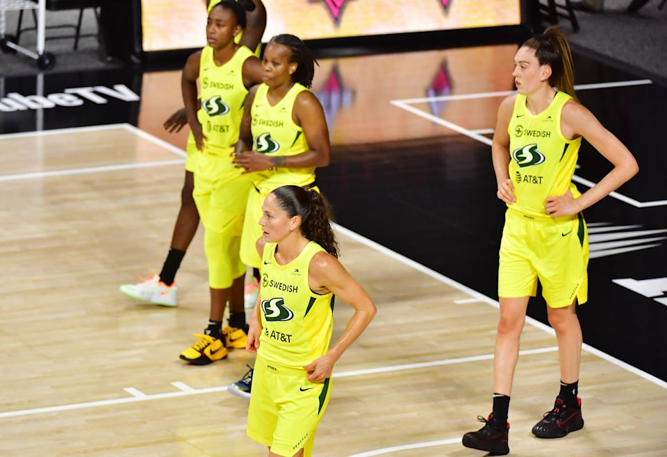 From left: Jewell Loyd, Epiphanny Prince, Sue Bird, Breanna Stewart in yellow jerseys on the court.