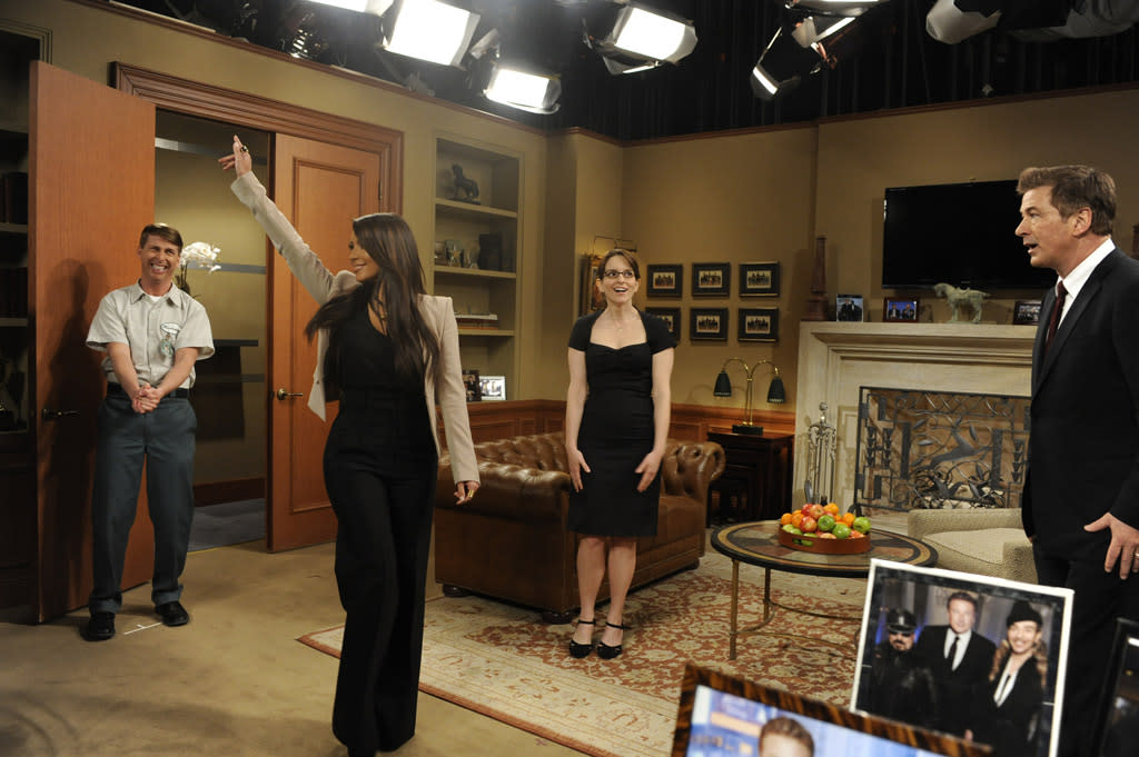 """Jack McBrayer as Kenneth Parcell, Kim Kardashian, Tina Fey as Liz Lemon, and Alec Baldwin as Jack Donaghy in the """"Live from Studio 6H"""" episode of """"30 Rock."""""""
