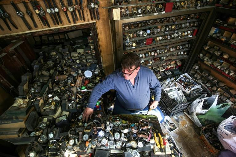 Thousands of watches fill Youssef Abdelkarim's tiny shop, where three generations have repaired Iraq's oldest timepieces