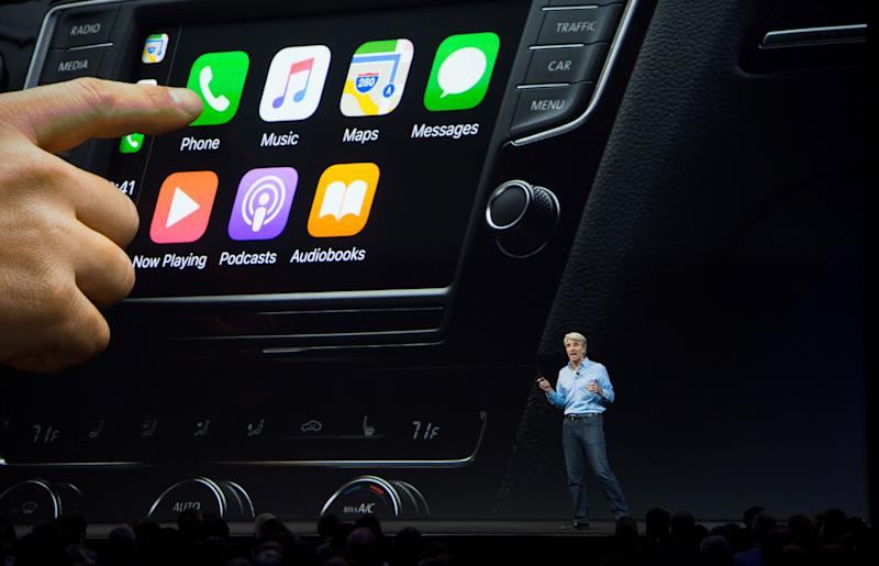 Apple's Senior Vice President of Software Engineering Craig Federighi speaks about CarPlay on stage during Apple's World Wide Developers Conference in San Jose, California on June 05, 2017. (PHoto: JOSH EDELSON/AFP/Getty Images)