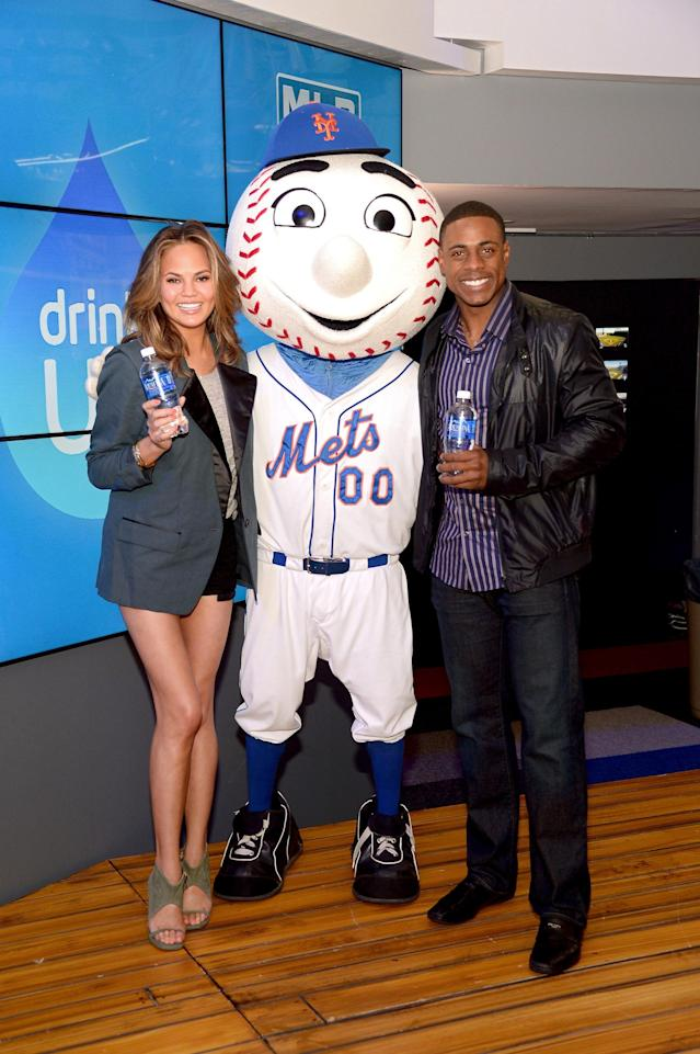 "NEW YORK, NY - MAY 08: Chrissy Teigen, Mr. Met and Curtis Granderson attend the The New National Campaign, ""Pledge. Drink. Win"", Encouraging Kids To Drink More Water at MLB Fan Cave on May 8, 2014 in New York City. (Photo by Michael Loccisano/Getty Images for Aquafina)"