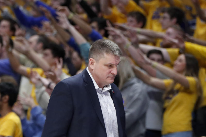 Boston College head coach Jim Christian walks in front of his bench as there team plays against Pittsburgh during the second half of an NCAA college basketball game, Wednesday, Jan. 22, 2020, in Pittsburgh. Pittsburgh won 74-72. (AP Photo/Keith Srakocic)