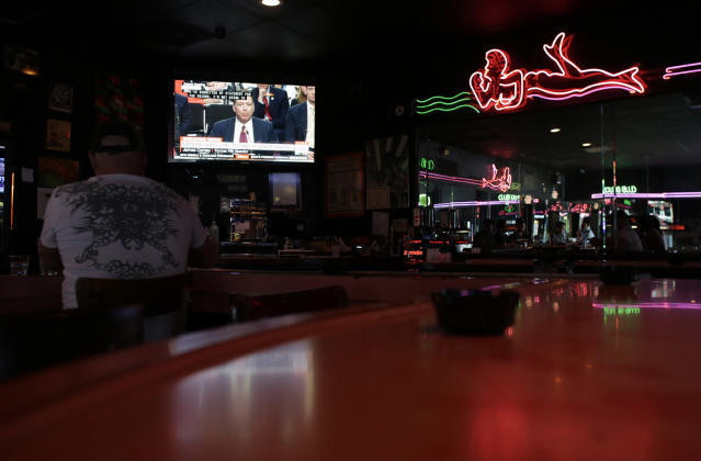 <p>Patrons at Mac's Club Deuce watch testimony by former FBI director James Comey before the Senate Intelligence Committee, June 8, 2017, in Miami Beach, Fla. (Lynne Sladky/AP) </p>