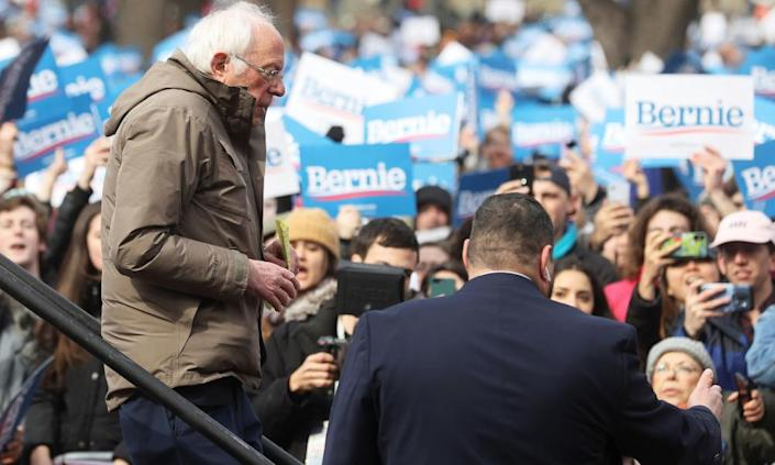 "<span class=""element-image__caption"">Bernie Sanders leaves the stage after delivering a speech during his rally in Boston, Massachusetts.</span> <span class=""element-image__credit"">Photograph: Jonathan Ernst/Reuters</span>"