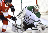 Dallas Stars goaltender Anton Khudobin (35) makes a save as Florida Panthers left wing Vinnie Hinostroza (13) closes in during the second period of an NHL hockey game Wednesday, Feb. 24, 2021, in Sunrise, Fla. (AP Photo/Jim Rassol)