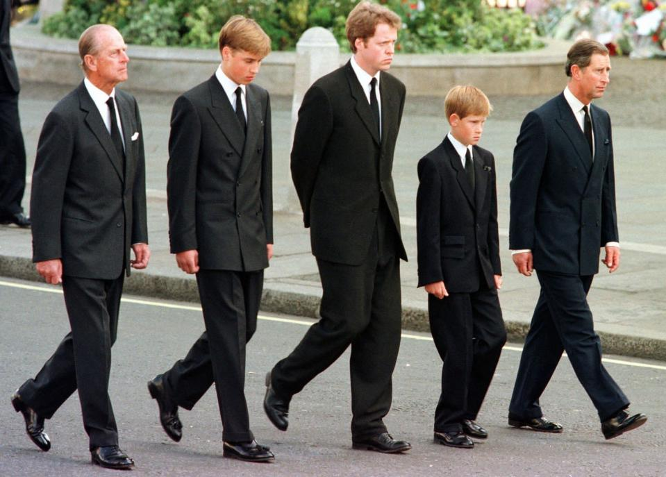 FILE - In this Sept. 6, 1997 file photo, from left, Britain's Prince Philip, Prince William, Earl Spencer, Prince Harry and Prince Charles walk outside Westminster Abbey during the funeral procession for Diana, Princess of Wales. Buckingham Palace officials say Prince Philip, the husband of Queen Elizabeth II, has died, it was announced on Friday, April 9, 2021. He was 99. Philip spent a month in hospital earlier this year before being released on March 16 to return to Windsor Castle. Philip, also known as the Duke of Edinburgh, married Elizabeth in 1947 and was the longest-serving consort in British history. (AP Photo/Jeff J. Mitchell, Pool, File)