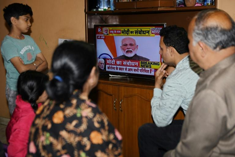 A familywatches Prime Minister Modi's address to the nation at their home in Amritsar (AFP Photo/NARINDER NANU)