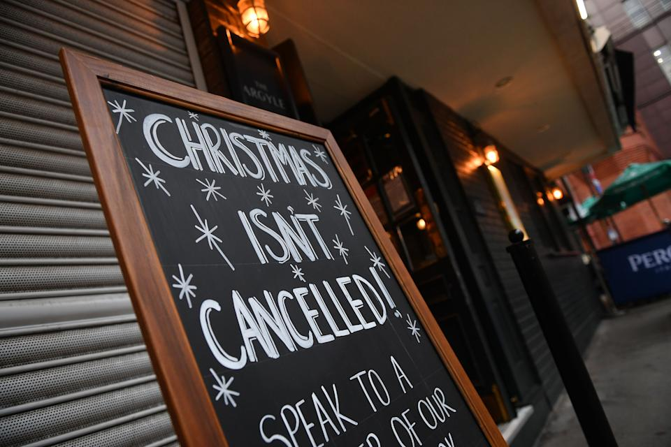 A sign outside a pub advertises a Christmas venue in London on October 21, 2020, as the government considers further lockdown measures to combat the rise in novel coronavirus COVID-19 cases. - Britain has suffered Europe's worst death toll from coronavirus, with nearly 44,000 deaths within 28 days of a positive test result. After a summer lull, cases are rising again as in other parts of the continent -- and so are deaths, with 241 reported on Tuesday alone. (Photo by JUSTIN TALLIS / AFP) (Photo by JUSTIN TALLIS/AFP via Getty Images)