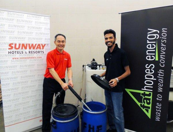 Mr. Colin Yeoh, Sunway Hotels & Resorts' Group Director of Food & Beverage with Mr. Vinesh Sinha, Chief Executive Officer and Founder, FatHopes Energy at the hotel's used cooking oil collection centre