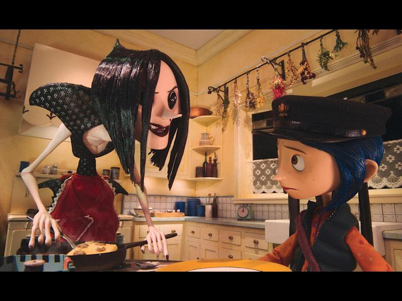 "Other Mother and Coraline in scene from movie ""Coraline"", photo on black"