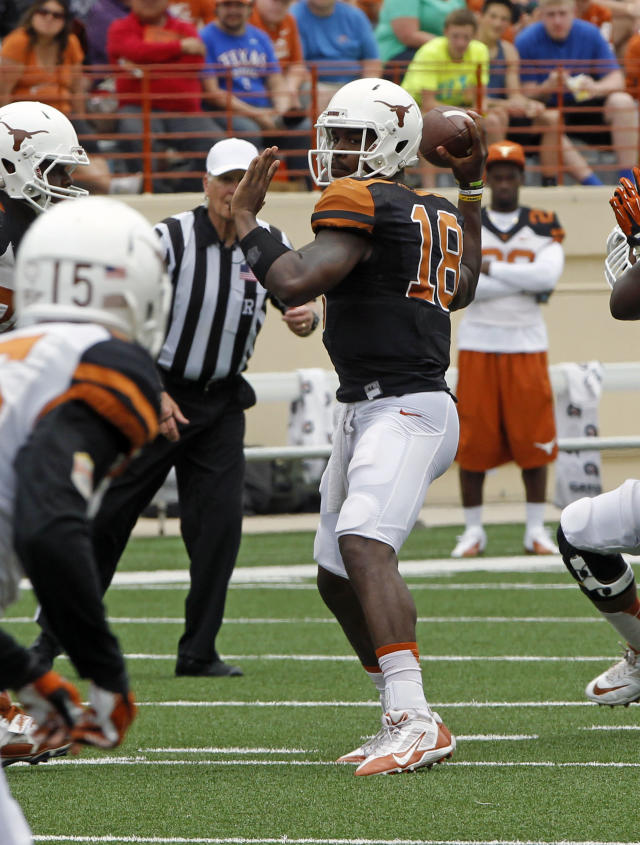 Texas quarterback Tyrone Swoopes (18) looks to throw during the first half of the Orange and White spring NCAA college football game on Saturday, April 19, 2014, in Austin, Texas. (AP Photo/Michael Thomas)