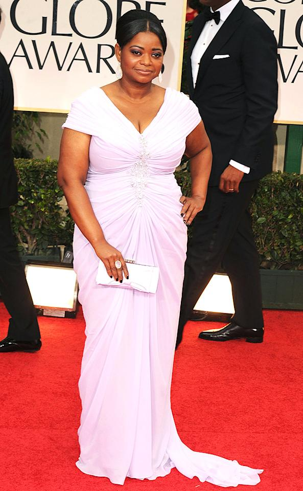 "<b>Octavia Spencer<br>Grade: A-</b><br><br>Octavia Spencer looked lovely in her updo and lavender gown by Tadashi Shoji. The Best Supporting Actress nominee (""The Help"") accessorized with Irene Neuwirth jewels, a Judith Leiber clutch, and a pair of Louboutins. ""I had to find something very low,"" she said during a pre-show interview."