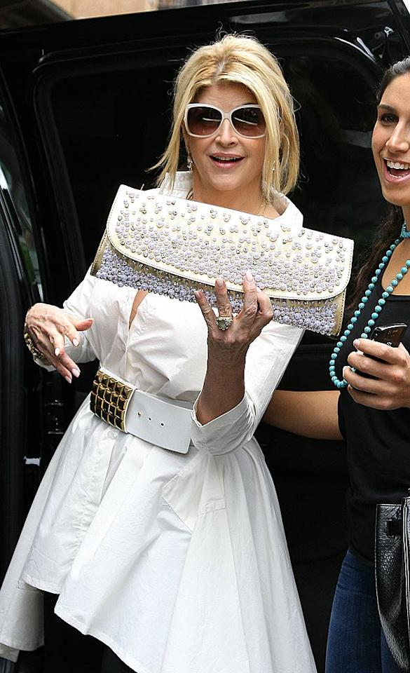 """Later, she donned yet another giant belt and showed off a cool crystal studded hand purse. Perhaps it was one of her new purchases! WasMEP/<a href=""""http://www.gettyimages.com/"""" target=""""new"""">GettyImages.com</a> - June 22, 2011"""