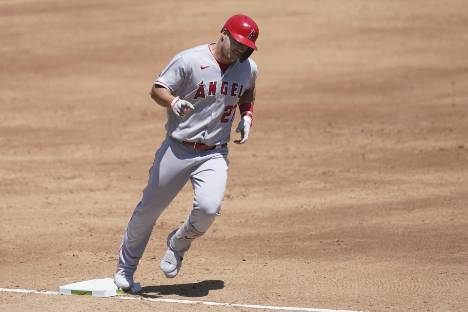 Los Angeles Angels' Mike Trout rounds the bases after hitting a three-run home run against the Oakland Athletics during the third inning of a baseball game in Oakland, Calif., Sunday, July 26, 2020. (AP Photo/Jeff Chiu)