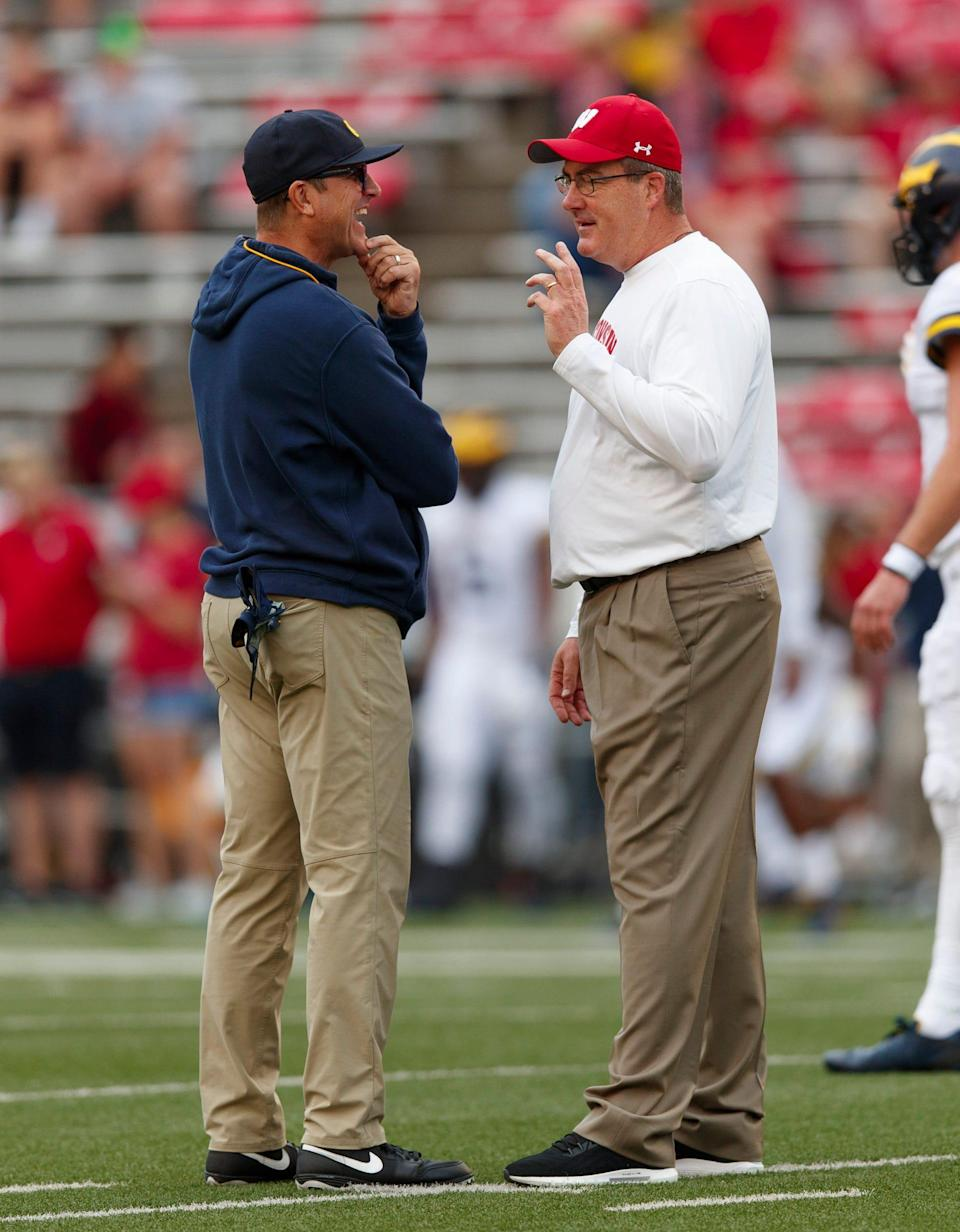 Wisconsin Badgers head coach Paul Chryst talks with Michigan Wolverines head coach Jim Harbaugh prior to the game at Camp Randall Stadium, Sept. 21, 2019 in Madison, Wis.