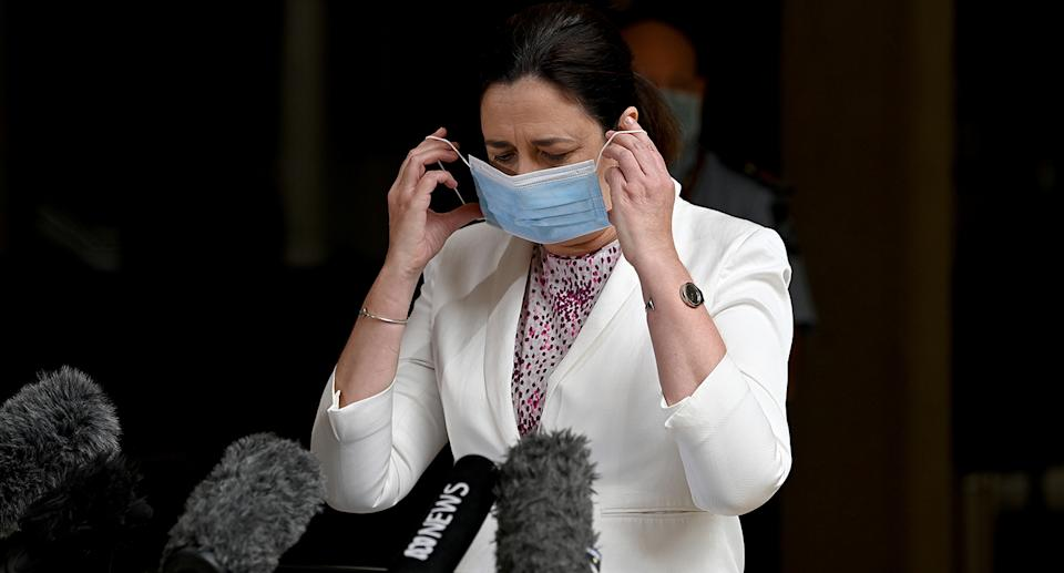 Queensland Premier Annastacia Palaszczuk takes off her mask to speak at Parliament House on March 30. Source: Getty