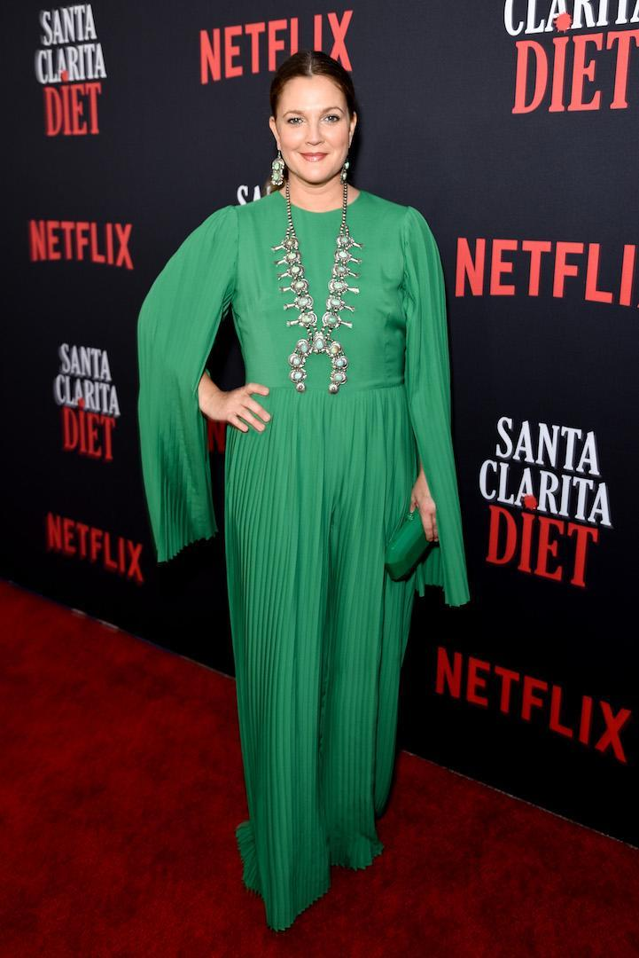 <p>Actress Drew Barrymore chose a spring-ready caped green dress for her most recent red carpet appearance. <em>[Photo: Getty]</em> </p>