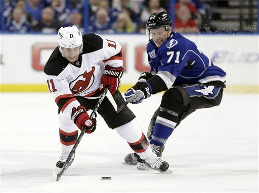 New Jersey Devils right wing Stephen Gionta (11) steals the puck from Tampa Bay Lightning right wing Richard Panik (71), of Slovakia, during the first period of an NHL hockey game, Friday, March 29, 2013, in Tampa, Fla. (AP Photo/Chris O'Meara)