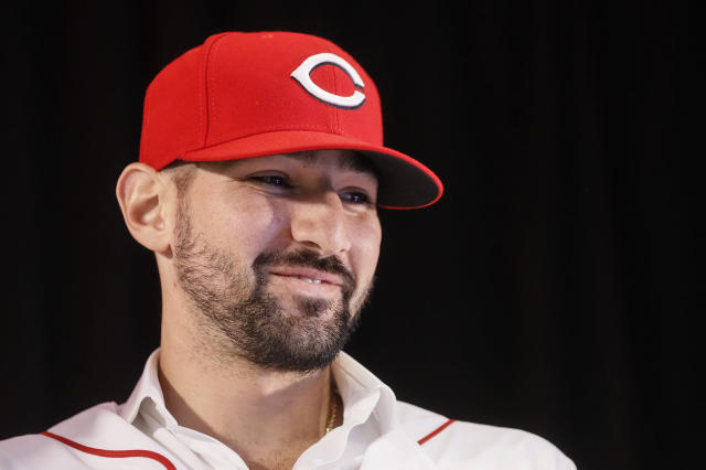 Cincinnati Reds' Nick Castellanos wears his cap during a news conference, Tuesday, Jan. 28, 2020, in Cincinnati. Castellanos signed a $64 million, four-year deal with the baseball club. (AP Photo/John Minchillo)