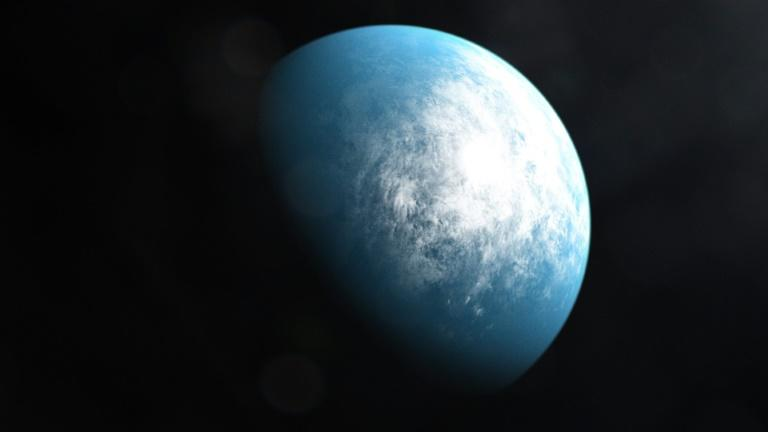 Planet TOI 700 d (shown in an artist's illustration) is the first Earth-sized habitable-zone world discovered by NASA's planet hunter satellite