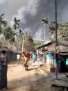 Smoke from a fire is seen at a Balukhali refugee camp in Cox's Bazar