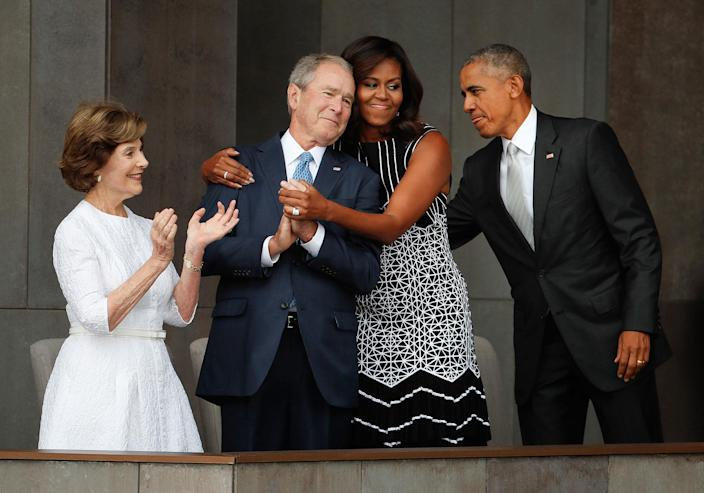 <p>SEPT. 24, 2016 — First lady Michelle Obama, center, hugs former President George W. Bush, as President Barack Obama and former first lady Laura Bush walk on stage at the dedication ceremony of the Smithsonian Museum of African American History and Culture on the National Mall in Washington. (AP Photo/Pablo Martinez Monsivais) </p>