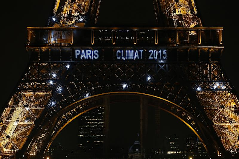 """The words """"Paris Climate 2015"""" are seen on the illuminated Eiffel Tower on November 22, 2013, in honour of the 21st Climate Change Conference which will take place in Paris"""